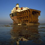 Massive hull sitting in the ocean waiting to be broken