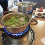 Tableside service for fish head soup—smart use of the whole fish, and fun!