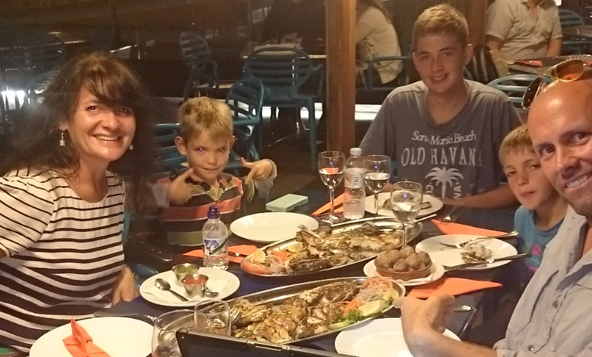 Treating a mother and her sons to a fish dinner (with an entire fish!) in Spain